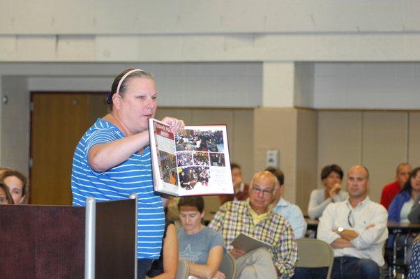 Tuckahoe first grade teacher Linda O'Brien addresses the board at Thursday's meeting.  DANA SHAW