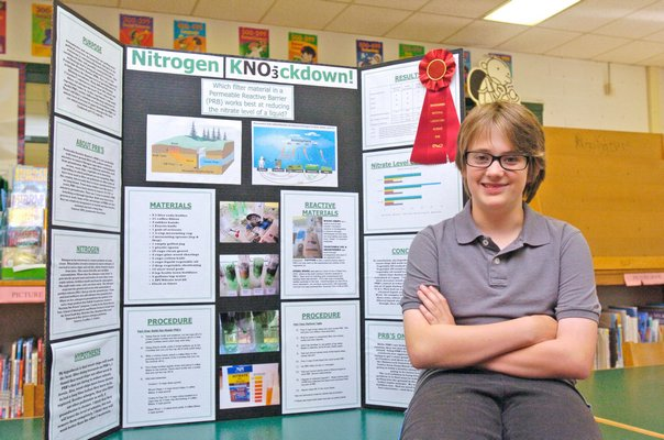 Daniel Stark with his award winning science fair project.  DANA SHAW