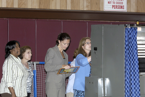 The voting machines are opened and votes are counted at Tuckahoe School on Tuesday night.  DANA SHAW