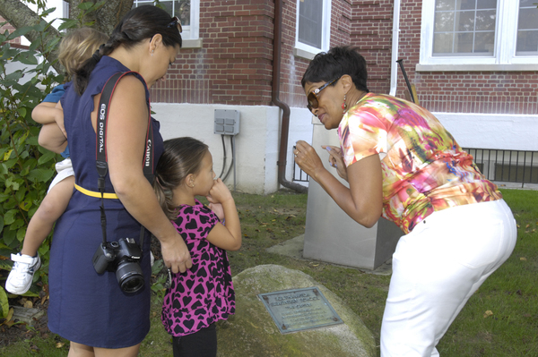 Southampton Elementary School Principal Cookie Richard with Nicole Fischette and her children. Ms. Fischette was a third-grade student at southampton Elementary and was present when the time capsule was buried.   DANA SHAW