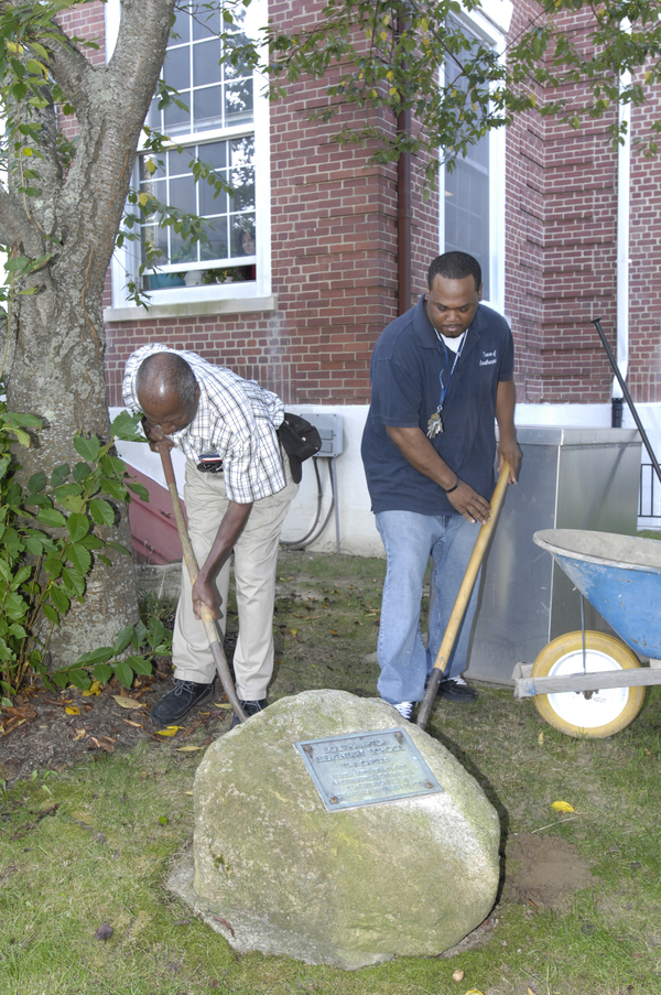 Former Southampton Elementary custodian Clarence Pinckney, left, who was present at the time capsule burial, helps dig.  DANA SHAW