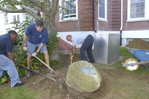 A crew from Southampton Town works to unearth the time capsule.  DANA SHAW