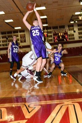 Hampton Bays freshman Kaitlyn Mounts gets through a mess of players to find an open shot. DANA SHAW