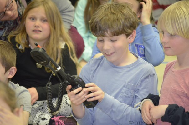 Brayden Pulaski from Remsenburg-Speonk Elementary School uses a walkie-talkie during a demonstration a