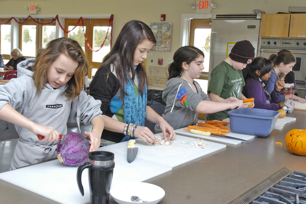 Students in Jeff's Kitchen at the Hayground School prepare a meal.