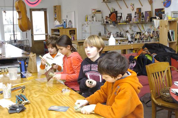 Students work on flutes in Jon Snow' class at the Hayground School.