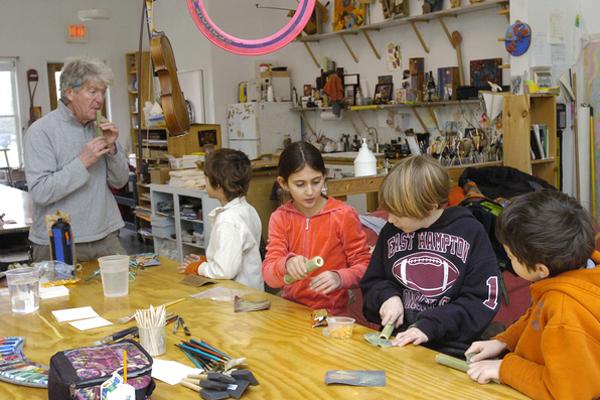 Students work on flutes in Jon Snow's class at the Hayground School.