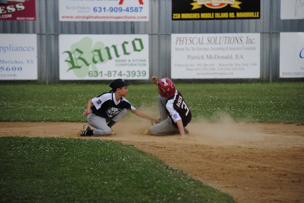 Tyler Hansen slides into second base and beats the tag. DANIELA DETORE