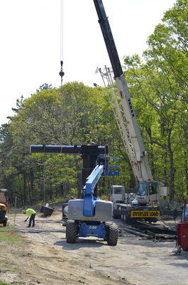 Work on the east bound billboard continues on Tuesday.