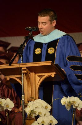 Southampton High School Principal Dr. Brian Zahn addresses the crowd at the 2014 graduation ceremony on Friday night. By Erin McKinley