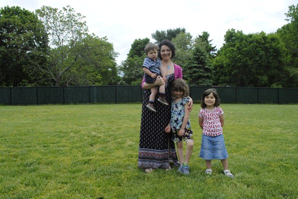 From left: Vanessa Parsons stands with her children William, 1, Emily, 6, and Clara, 3, where the garden would be built. AMANDA BERNOCCO
