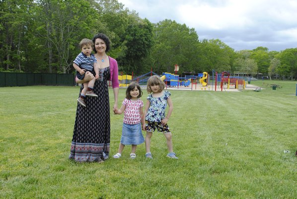 From left: Vanessa Parsons stands with her children William, 1, Clara, 3, and Emily, 6, where the garden would be built. AMANDA BERNOCCO