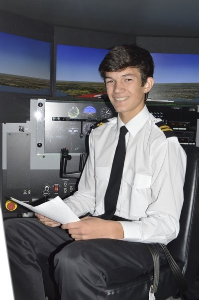 Southampton High School Senior Michael Minogue inside a flight simulator at the Eastern Suffolk BOCES campus in Brookhaven, where is in enrolled in a pilot training program through Academy LI at Bixhorn Technical Center. ALYSSA MELILLO