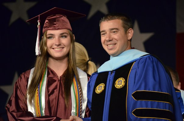 Noelle Crough with Southampton High School Principal Dr. Brian Zahn at the 2014 graduation ceremony on Friday night. By Erin McKinley