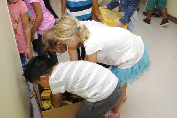 Students in Kristin Webber's second grade class at Hampton Bays Elementary School are donating crayons to a school in Texas that was devestated by Hurricane Harvey. AMANDA BERNOCCO