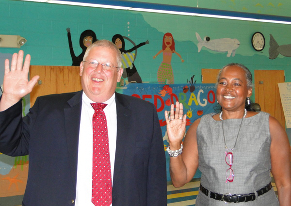 Southampton School Board members Don King and Roberta Hunter take the oath of office in the Southampton Elementary School cafeteria on July 7.