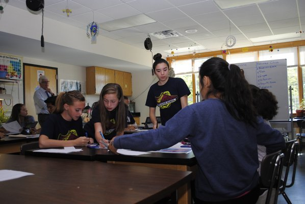 The seventh grade students in Dennis Schleider's class participated in an eMission project, where they had to work together to save the residents of the island of Montserrat from a volcanic eruption in the face of an approaching hurricane. AMANDA BERNOCCO