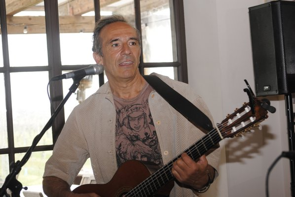 Alfredo Merat, a musician living in Springs, will play his guitar at the vigil in Good Ground Park in Hampton Bays on Saturday. AMANDA BERNOCCO