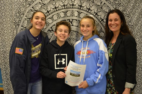 From left to right: Westhampton Beach Middle School students Reilly Mahon, Anthony Agudelo and Lauren Goss, and English teacher Kelly Russell. ANISAH ABDULLAH