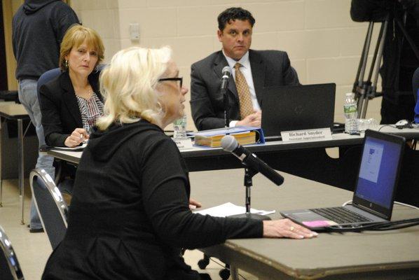 Marion Diener, of Manorville, addresses the board about Superintendent Mark Nocero's retirement. AMANDA BERNOCCO