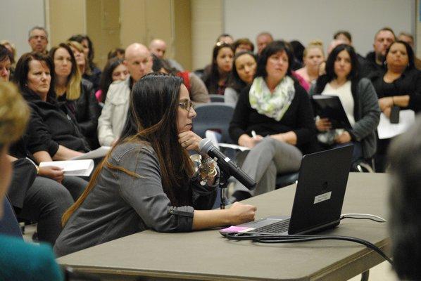 Jen Kelly, of Manorville, addresses the board about Superintendent Mark Nocero's retirement. AMANDA BERNOCCO