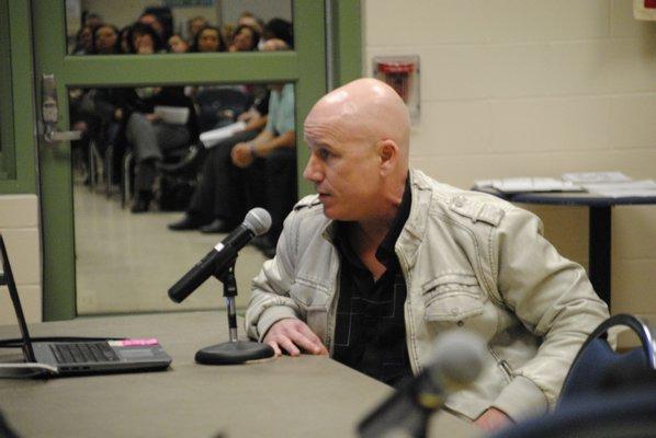 Ken Colvin, of Manorville, addresses the board about Superintendent Mark Nocero's retirement. AMANDA BERNOCCO