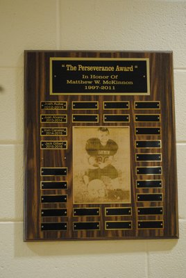 The names of the recipients of the Perseverance Award, in memory of Matthew McKinnon, are displayed on a plaque outside the Hampton Bays Middle School gymnasium. AMANDA BERNOCCO