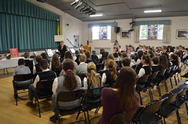Sixth-, seventh- and eighth-grade students from Our Lady of the Hamptons School listened to Bozenna Urbanowicz Gilbride speak about her experience living through the Holocaust. ANISAH ABDULLAH