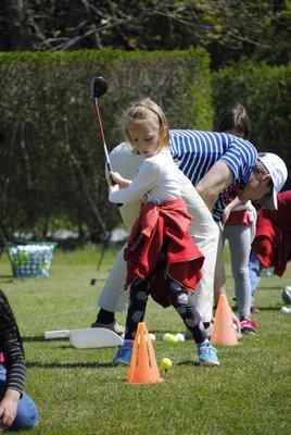 Morgan Mcarty, a kindergartener, takes a swing at Quogue Field Club. AMANDA BERNOCCO