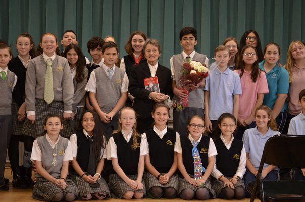 Bozenna Urbanowicz Gilbride posing with students after the event concluded. ANISAH ABDULLAH