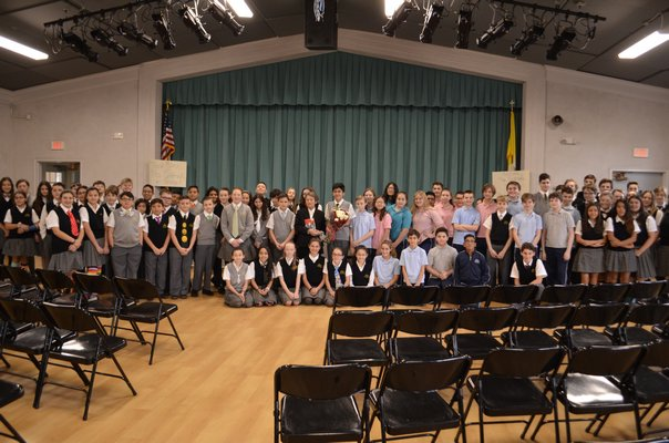 Bozenna Urbanowicz Gilbride with all of the students in attendance after the event concluded. ANISAH ABDULLAH
