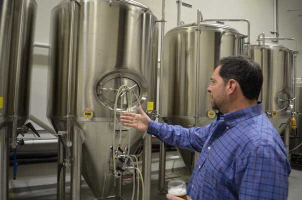 Westhampton Beach Brewing Company co-owner Brian Sckipp explains how their space at Hampton Business District allows them to do all aspects of business operations. ANISAH ABDULLAH