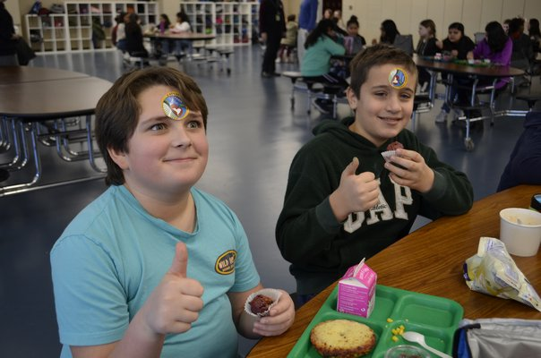 "Sixth graders at Southampton Intermediate School enjoying the ""red velvet"" beet muffins. ANISAH ABDULLAH"