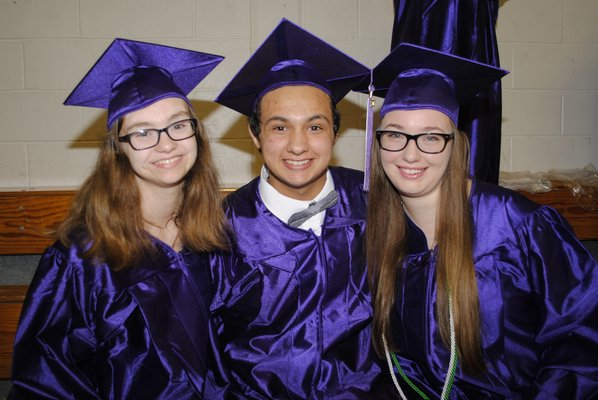 From left: Hannah Goetz, Josh Albarino and Julia Tetrault  graduated on Saturday afternoon. AMANDA BERNOCCO