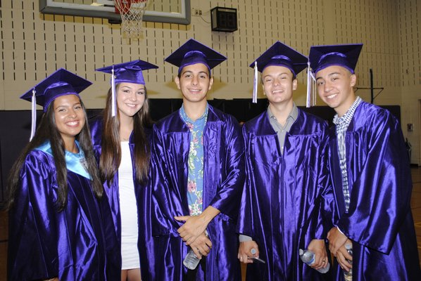 From left: Tiffany Brenes, Emily Lowry, Dario Vasquez, Miguel Flores and Gabriel Guambana graduated on Saturday afternoon. AMANDA BERNOCCO