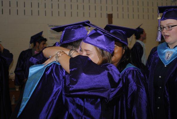 Amelia Salvatore embraces Nicholas Kolb during graduation on Saturday afternoon. AMANDA BERNOCCO
