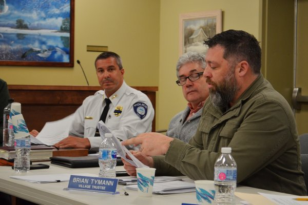 Village Board member Brian Tymann speaking at the Village Board work session on February 20. Also pictured are Building and Zoning Administrator Paul Houlihan and Police Chief Trevor Gonce. ANISAH ABDULLAH