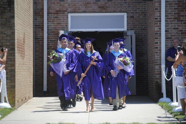 From left: Valedictorian Erik Morastitla, Class President Alexandra Macholz, and Salutatorian Nicholas Kolb graduated on Saturday afternoon. AMANDA BERNOCCO