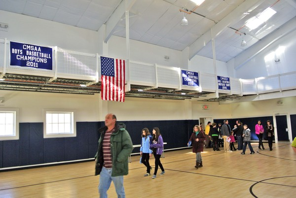 Students and parents in the new gym at OLH on Sunday morning.  DANA SHAW