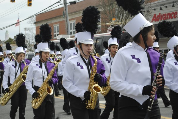 Students from the Hampton Bays High School band march during the St. Patrick's Day parade. AMANDA BERNOCCO
