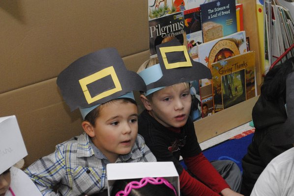 J.J. Hillen, left, and Henry Rose learn about Thanksgiving at Hampton Bays Elementary School. AMANDA BERNOCCO