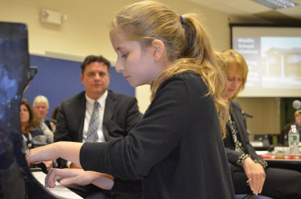 Rebecca Nelsen, a seventh-grader at Eastport South Manor Junior-Senior High School, performed for the Board of Education at last month's meeting. ALEXA GORMAN