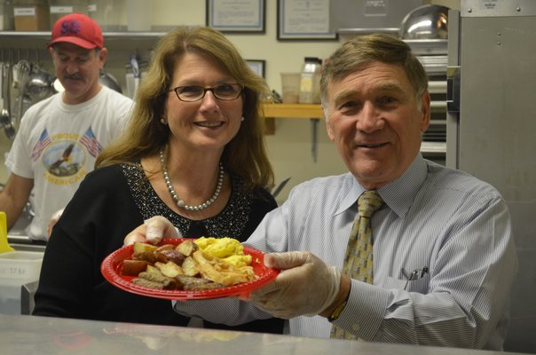 District Clerk Linda Springer and Superintendent Joseph Chris Dyer serve breakfast to local veterans on Monday morning at the Tuckahoe School. BY ERIN MCKINLEY