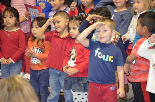 Tuckahoe students salute local veterans on Monday morning during a Veteran's Day breakfast at the Magee Street school. BY ERIN MCKINLEY
