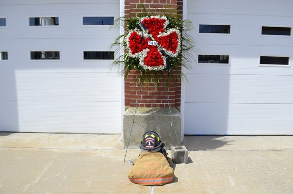 Edward Corrigan's firefighter suit and helmet on display outside of the Southampton Fire Department. ANISAH ABDULLAH