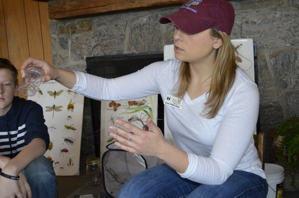 Renee Allen, environmental educator at the Quogue Wildlife Refuge, showed campers how a stick bug sheds its skin. ALEXA GORMAN
