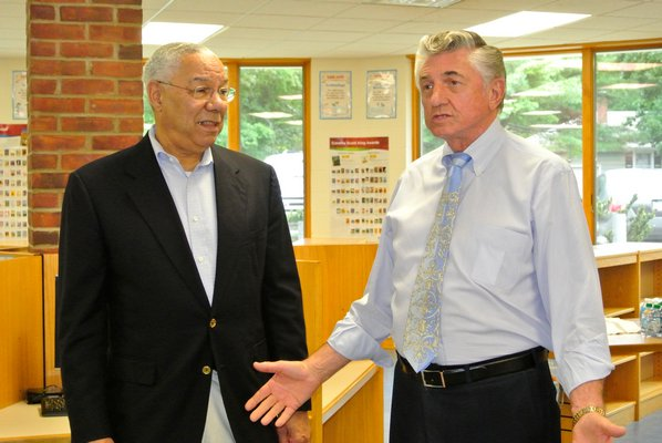 General Colin Powell with Robert Grisnik at the Tuckahoe School on Tuesday morning. DANA SHAW