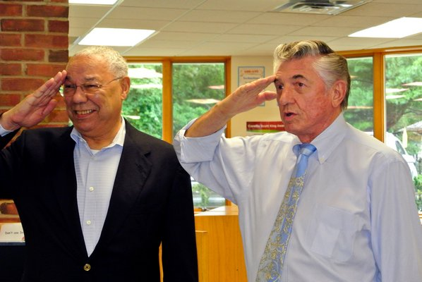 General Colin Powell and Robert Grisnik return salute to Tuckahoe students on Tuesday morning. DANA SHAW