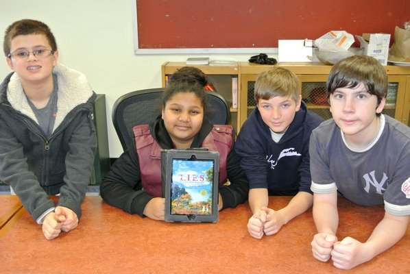 Students David Mahoney, Aidan Wisniewski-Campo, Nashota Williams, and Wayne Moore, along with their seventh-grade social studies class, are petitioning the school district to no longer celebrate Christopher Columbus. BY DANA SHAW
