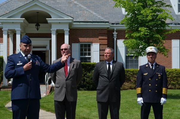 Lt. Col Robert Siebelts, Quogue Mayor Peter Sartorius, local artist Steven Alpert and Quogue Fire Chief Bruce Davidson at the Memorial Day service. Alexa Gorman